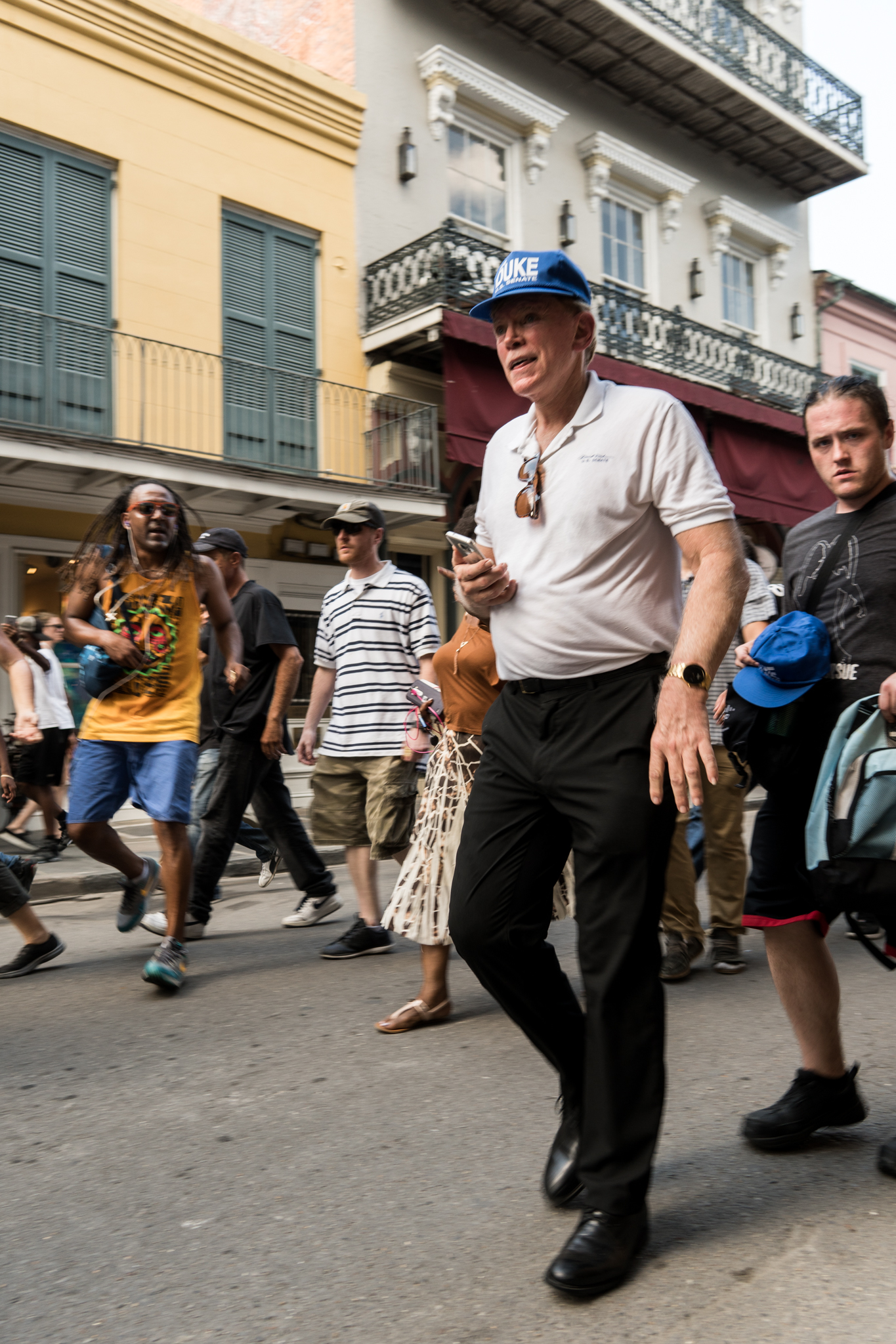 Protesters chase David Duke down Chartres Street in the French Quarter.