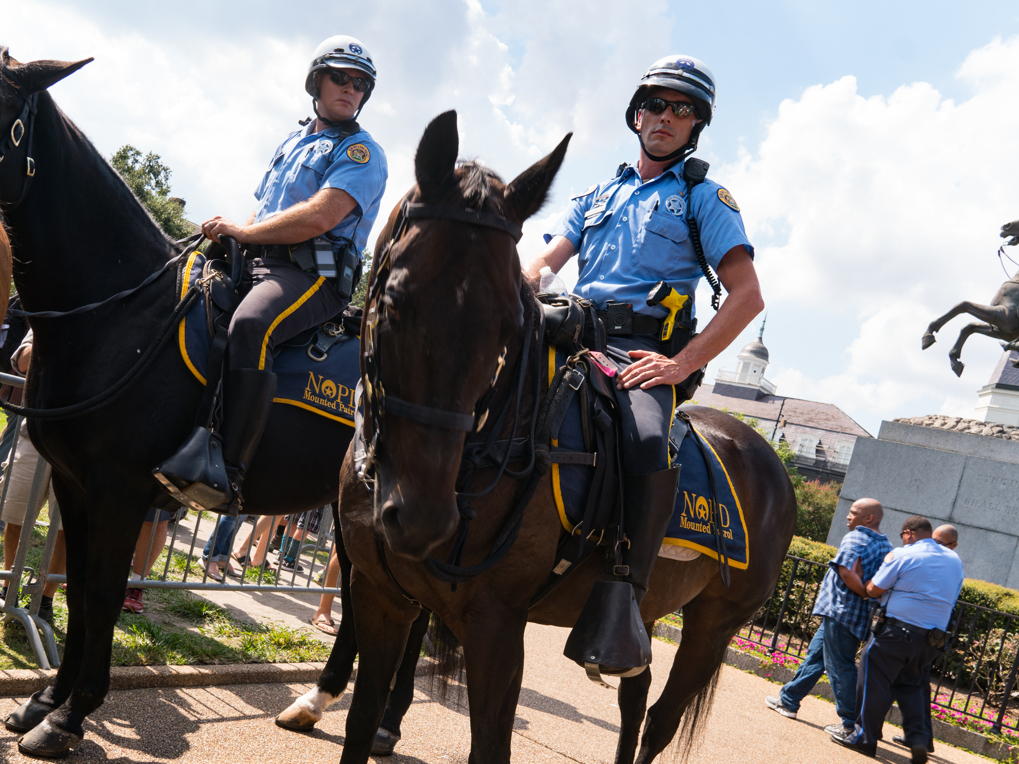 NOPD officers stand guard in front of the statue of Andrew Jackson in Jackson Square.