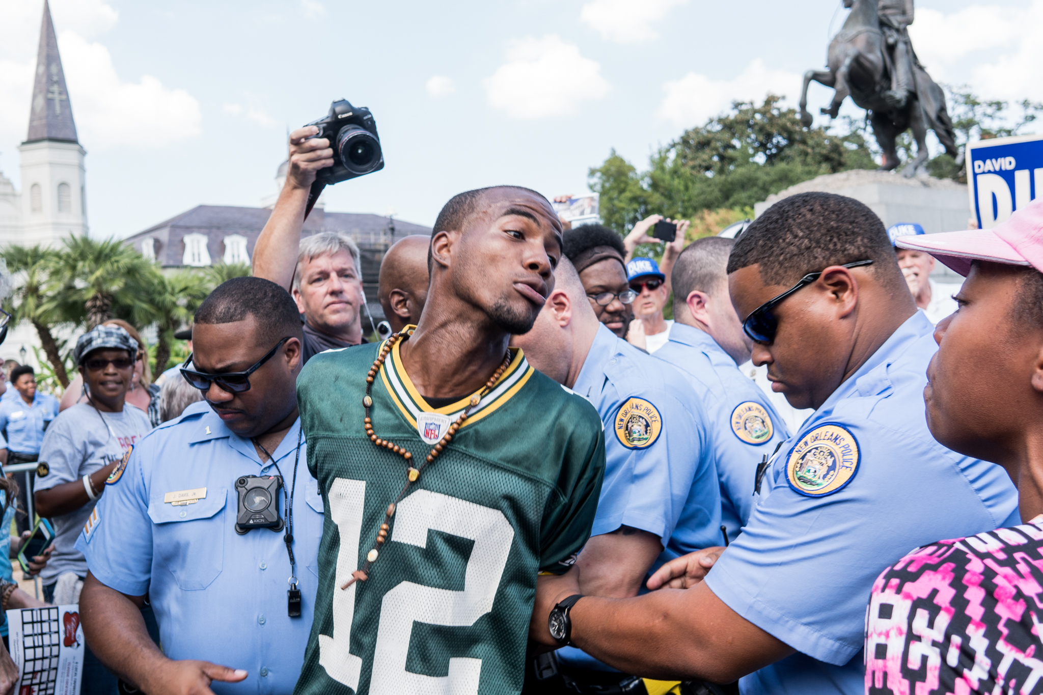 A protester is led away in handcuffs by New Orleans Police officers.