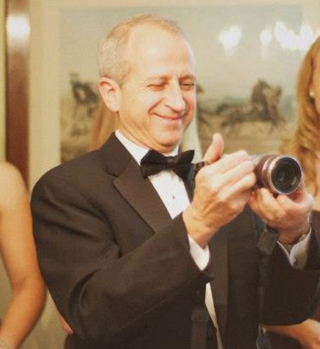 You know, we hired a real wedding photographer! But dad wanted to be sure he got his own memories, and he seems happy doing it!