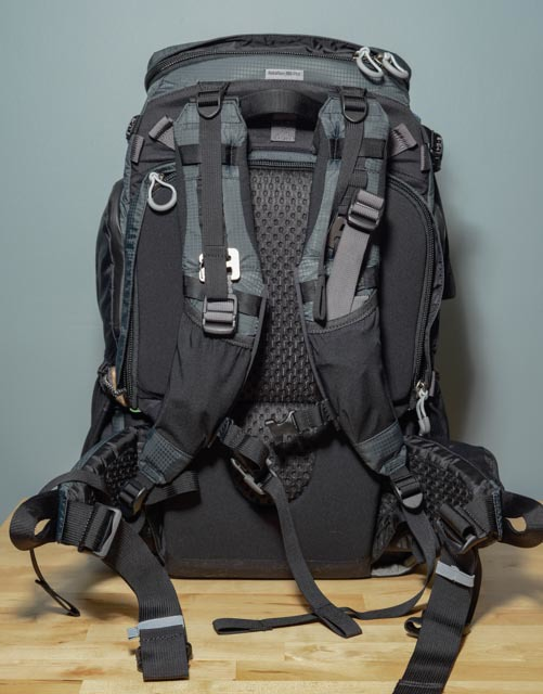 The shoulder strap assembly has several adjustment points, allowing for almost custom fit on this bag. In this photo I also have the rigging for the optional tripod mount attached (the carabiners on each shoulder strap). The back pad also has a nice mesh panel to help keep you cool.