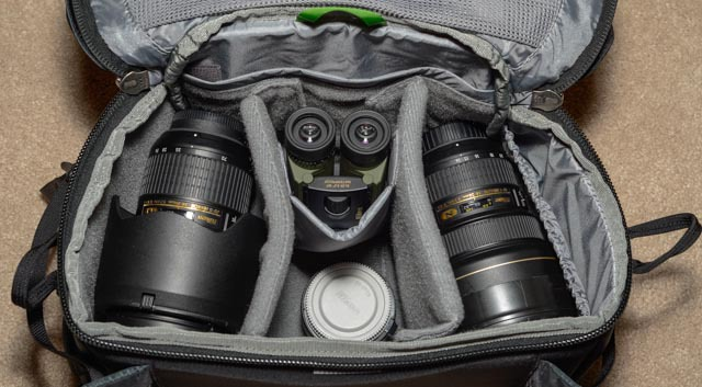 A more realistic load out in the waist bag. I almost always carry my camera in my hands vs in the bag, so I didn't worry about making space for the D800. I have (from left to right): Nikon 24-70mm, binoculars, 1.4x teleconverter, and Nikon 14-24mm lens. Plenty of space for more filters or a speedlight.