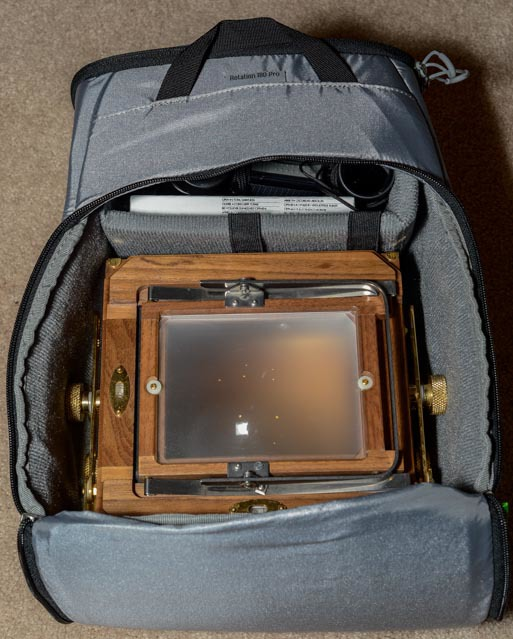 I will have to use the padded insert in the main compartment when I carry my Zone VI large format (4x5) film camera. The camera takes up the majority of the compartment, but I have space on top for a box of film, my light meter and loupe. Note: I would carry the camera body in it's protective wrap, but removed that for the sake of the photo.