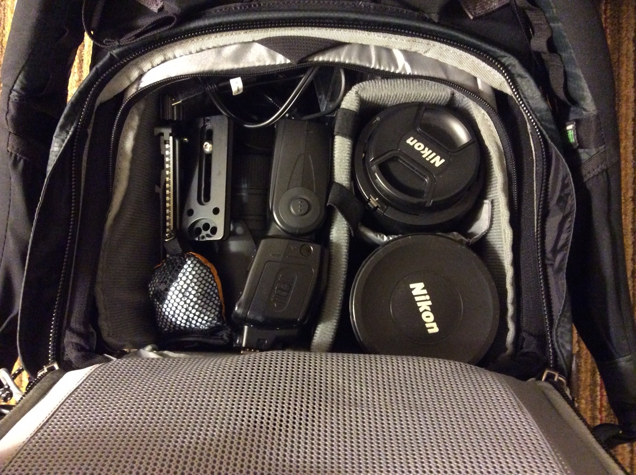 Inside the back compartmented of the Mindshift Gear Rotation 180 - I have jammed it full of gear! I would probably never hike with it like this since it's just jammed up, but this was the best way to transport all of the essentials, including lenses, flashes, camera bodies, chargers, filters, and more.