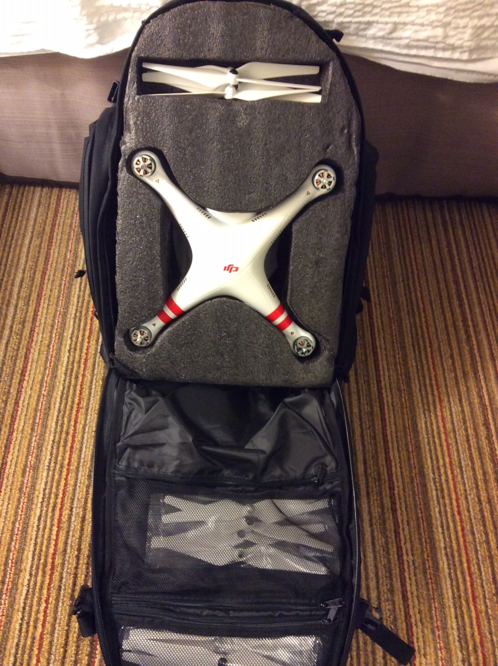 "The DJI Phantom Vision 2+ Quadcopter in my custom made backpack. This will be the second ""personal item"" we will carry on the plane."