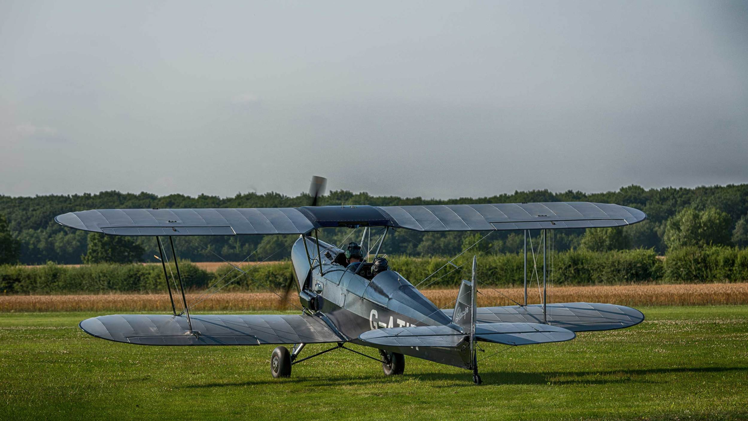 The Stampe taxiing towards the grass airstrip at the Little Gransden airfield. It flew for about a hour today, offering its passengers some breathtaking views of the British countryside.