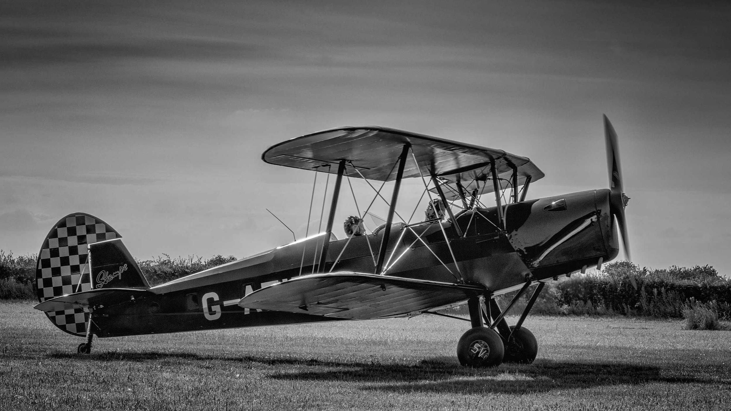 I usually find that aircraft photographs either look better in black and white or color, based on the personality of the aircraft and story I'm trying to tell.... but this Stampe is the exception and looks gorgeous in both!