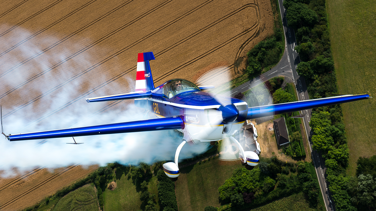 Now it's Chris' turn to show off the nose of his blue Extra as we fly over a farm house in rural England.