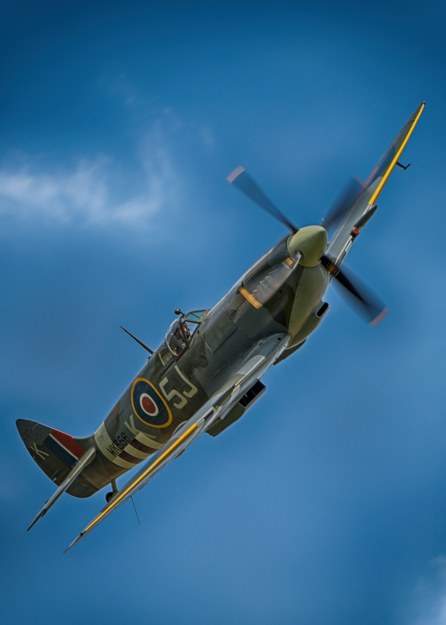 If you look closely on this Spitfire, you can see a series of white stripes on the wings and underside of this fighter - those stripes are called invasion stripes and were painted using mops and whatever white paint could be found before the Allied invasion on D-Day. These are obviously a re-paint since the real stripes were applied crudely just hours before the invasion.