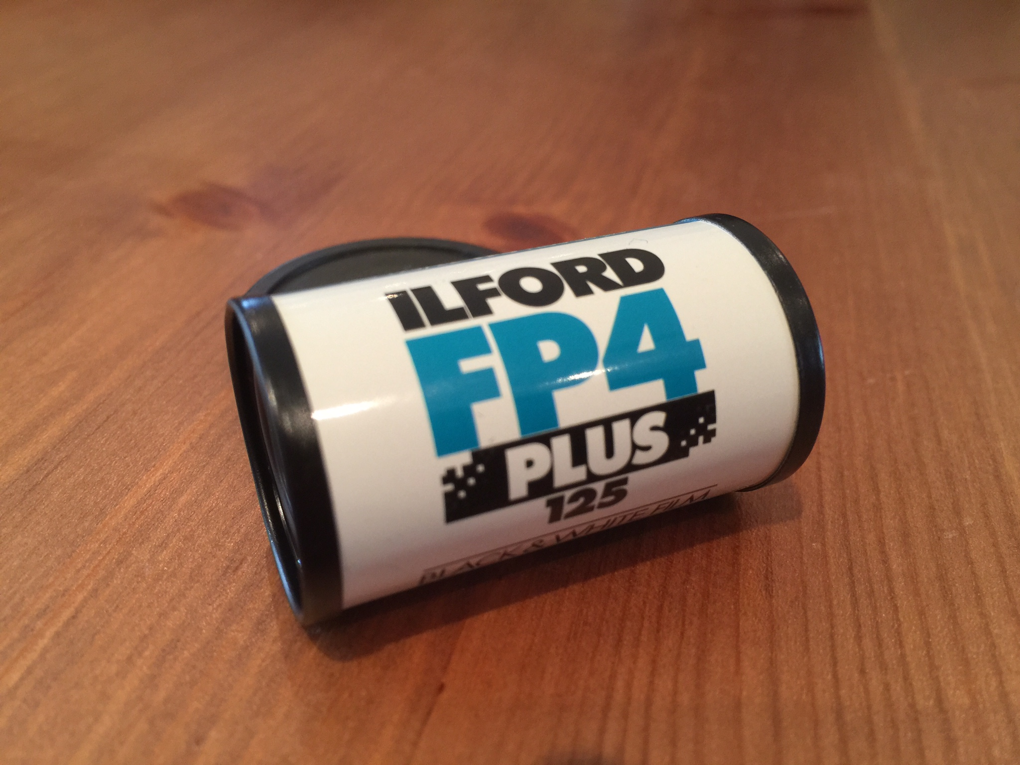 The exterior of a 35mm Ilford FP4 Plus canister