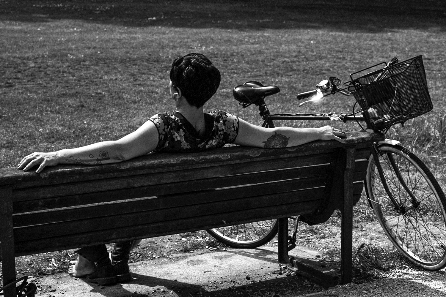 This woman was relaxing to enjoy one of the first nice days this spring. I was convinced to take the photograph because of her tattoos and seeing that she'd taken her shoes off.