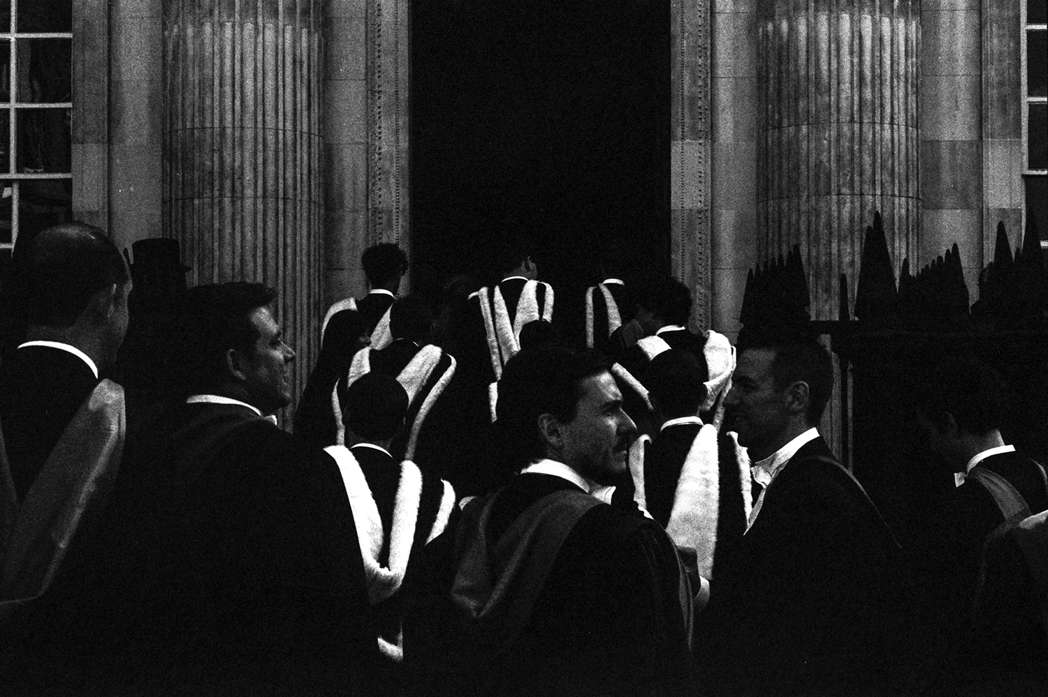 Soon-to-be graduates from one of the Cambridge University colleges line up in procession to enter their graduation ceremony. I intentionally underexposed to create a stark contrast between the black and white of their robes.