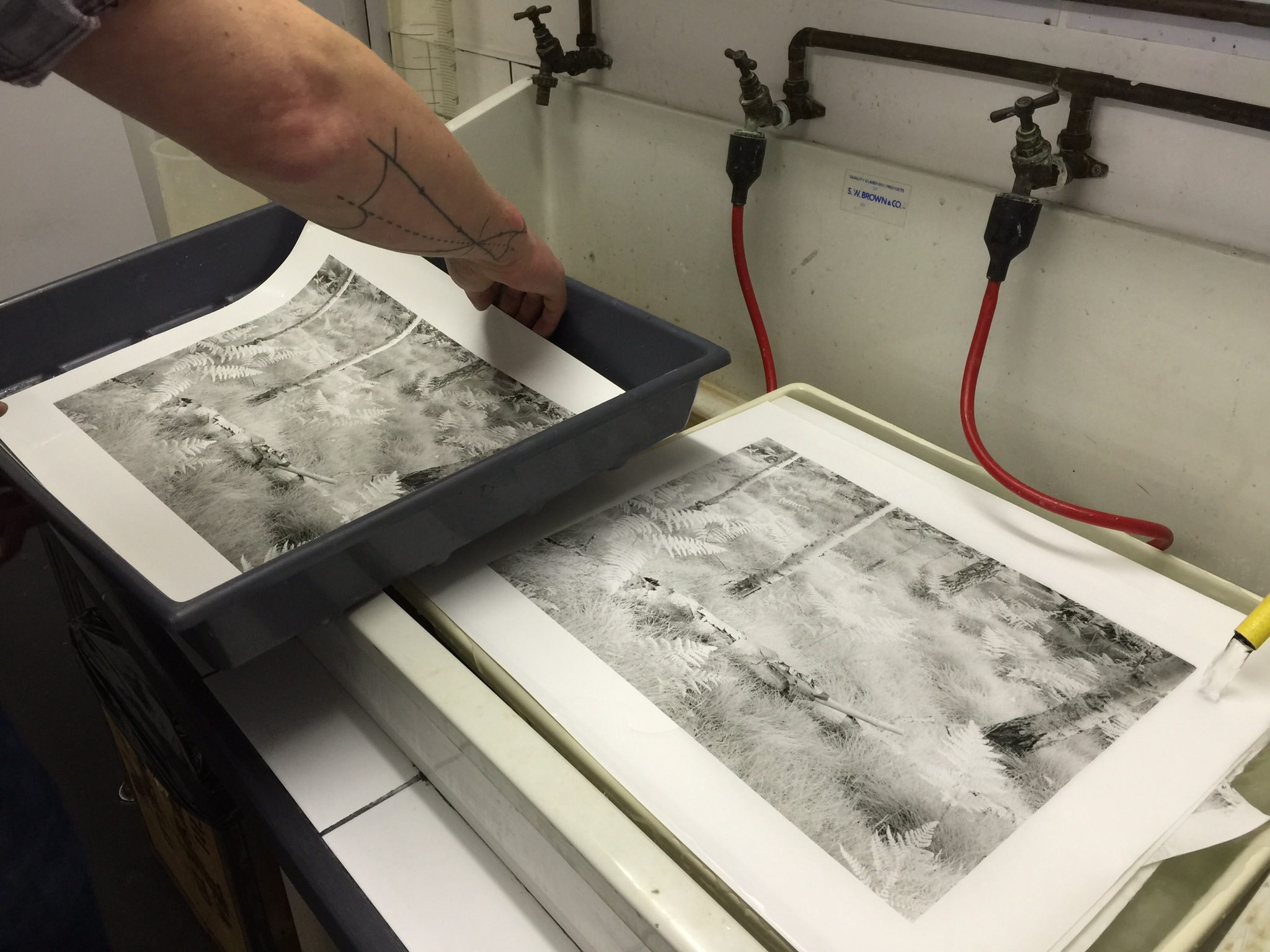 Looking at some of the prints John made under our watch. Although it's a basic iPhone photo, you can still tell the difference in tonality between the two prints, which are made from the same negative.