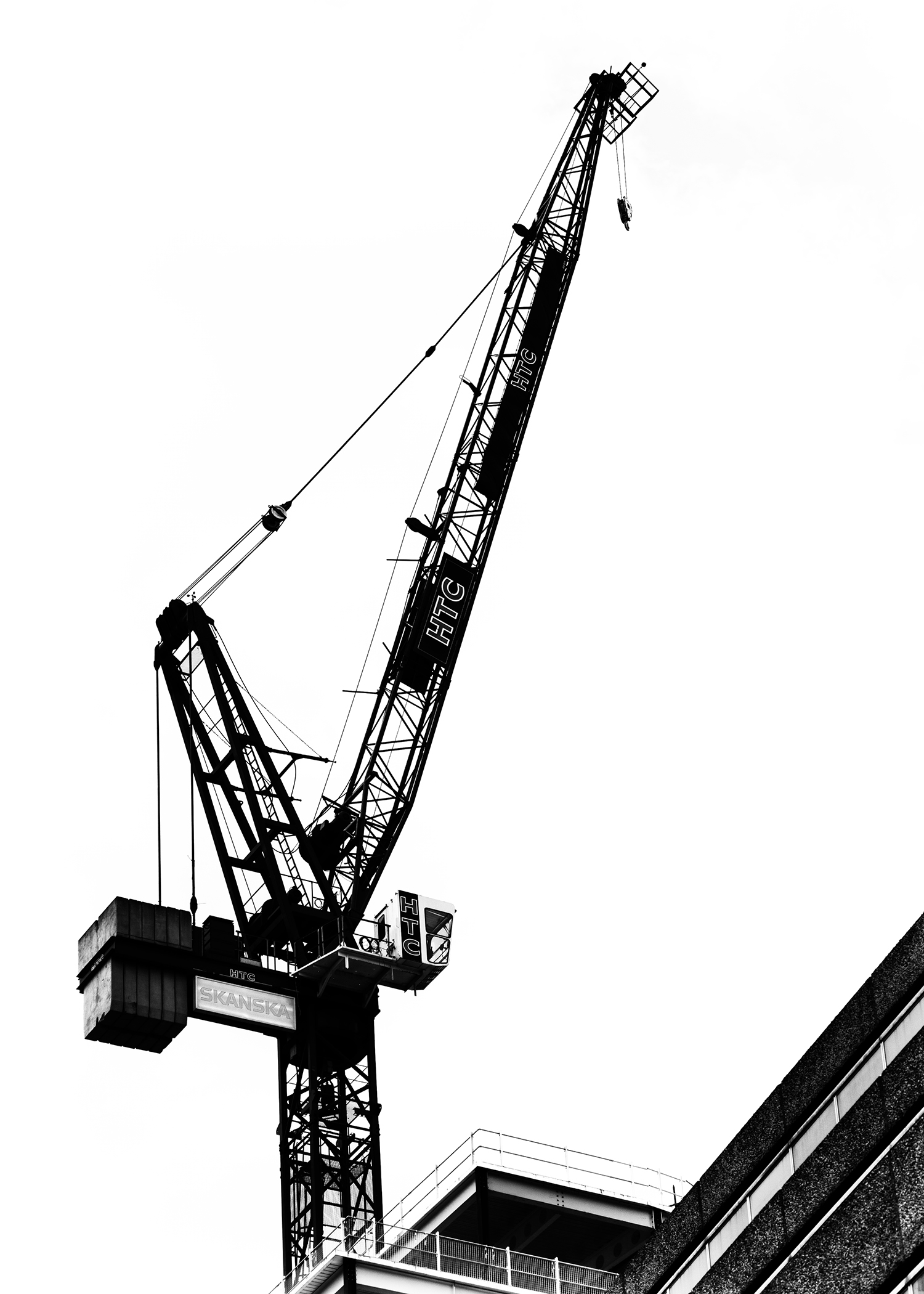 A construction project silhouette against the bright white clouds on an overcast London afternoon