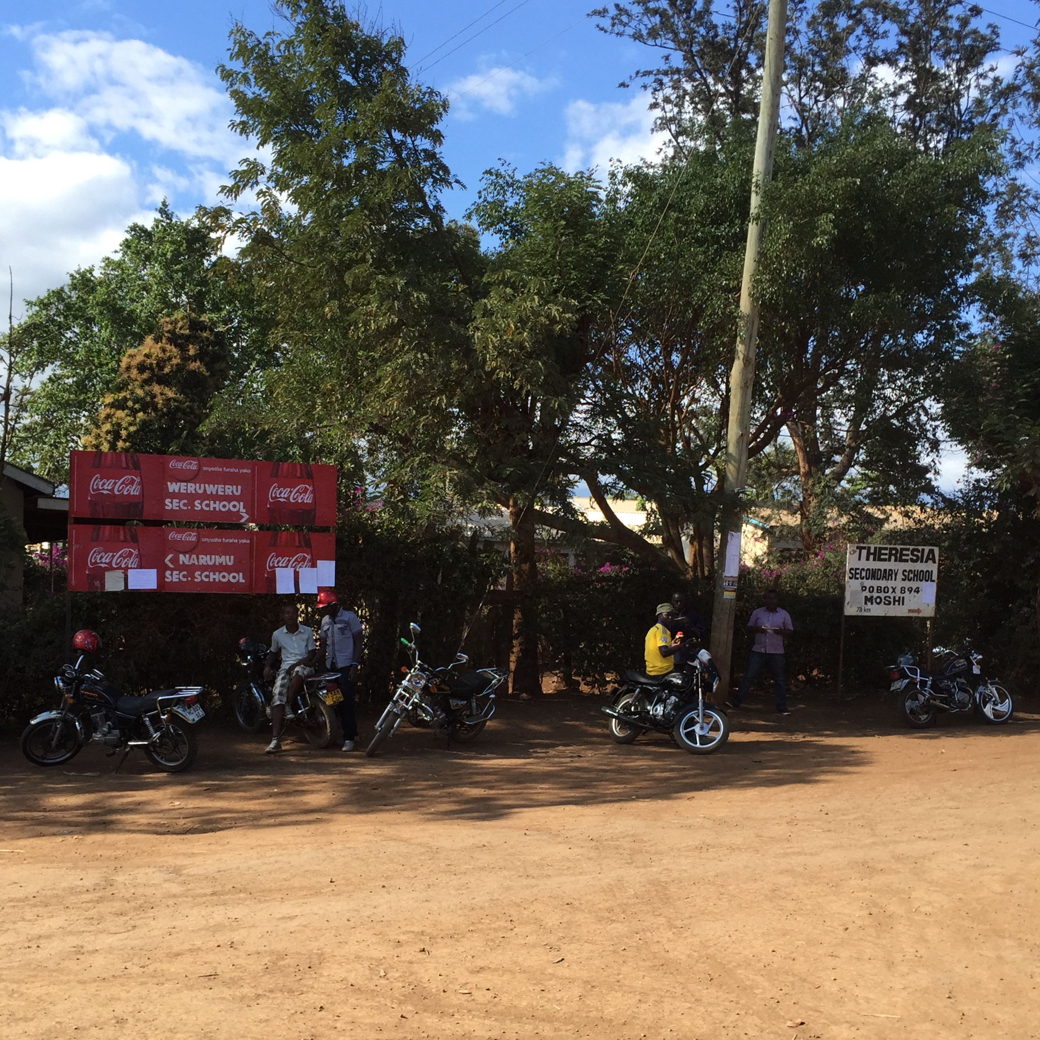 Some locals with their motorbikes gathered outside the school in Weru Weru. I guess the school serves Coke?!
