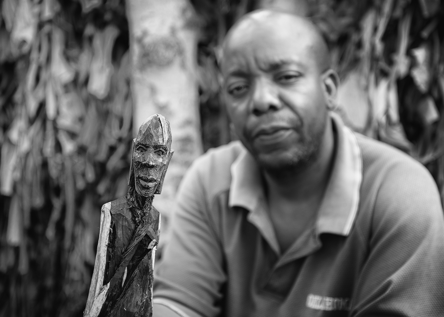 This man carves ebony figurines to make money to feed his family