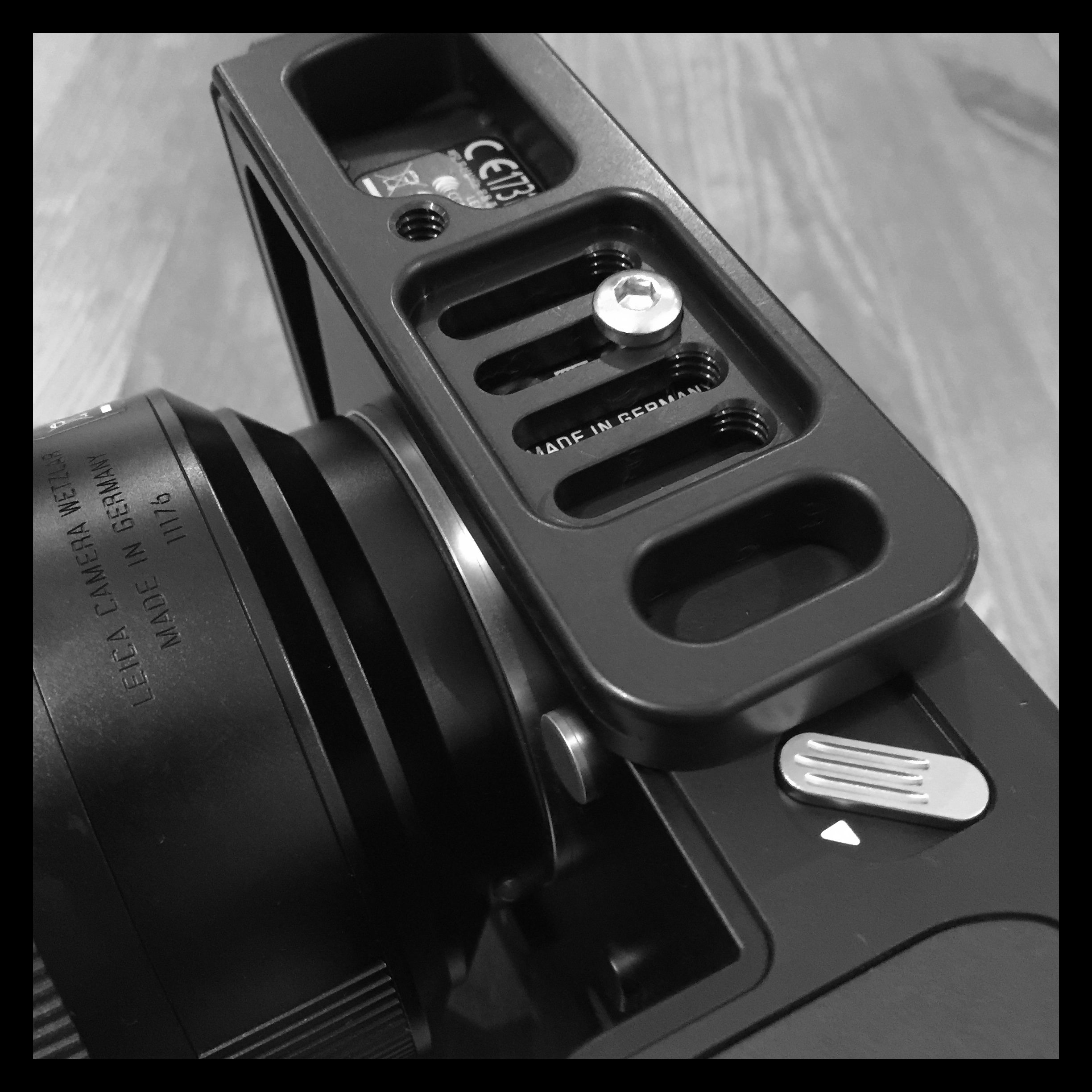 The length of the L-plate, when mounted in the second slot like pictured, still leaves space to access the battery hatch and release.