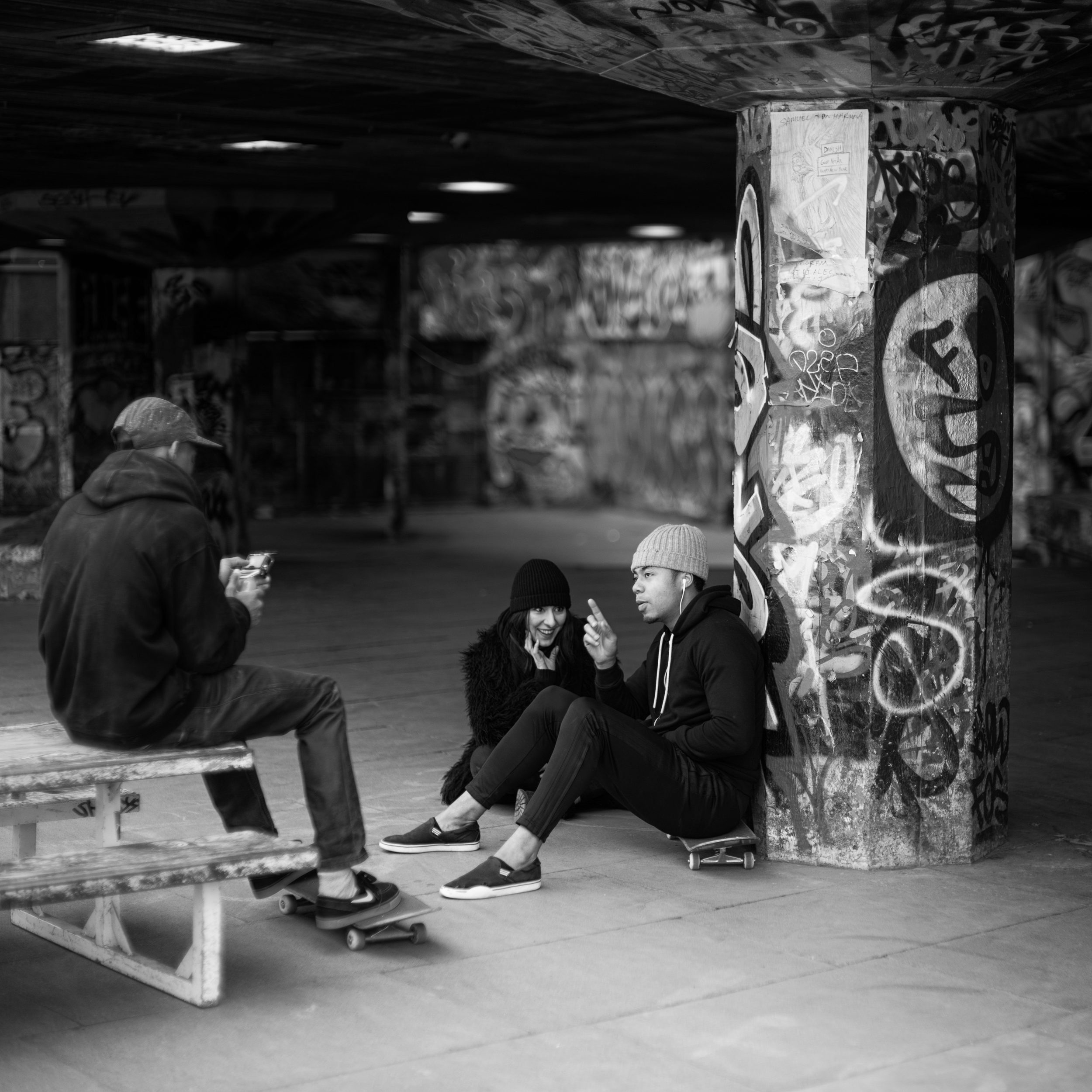 Skaters take a break to have a discussion near Southbank Center