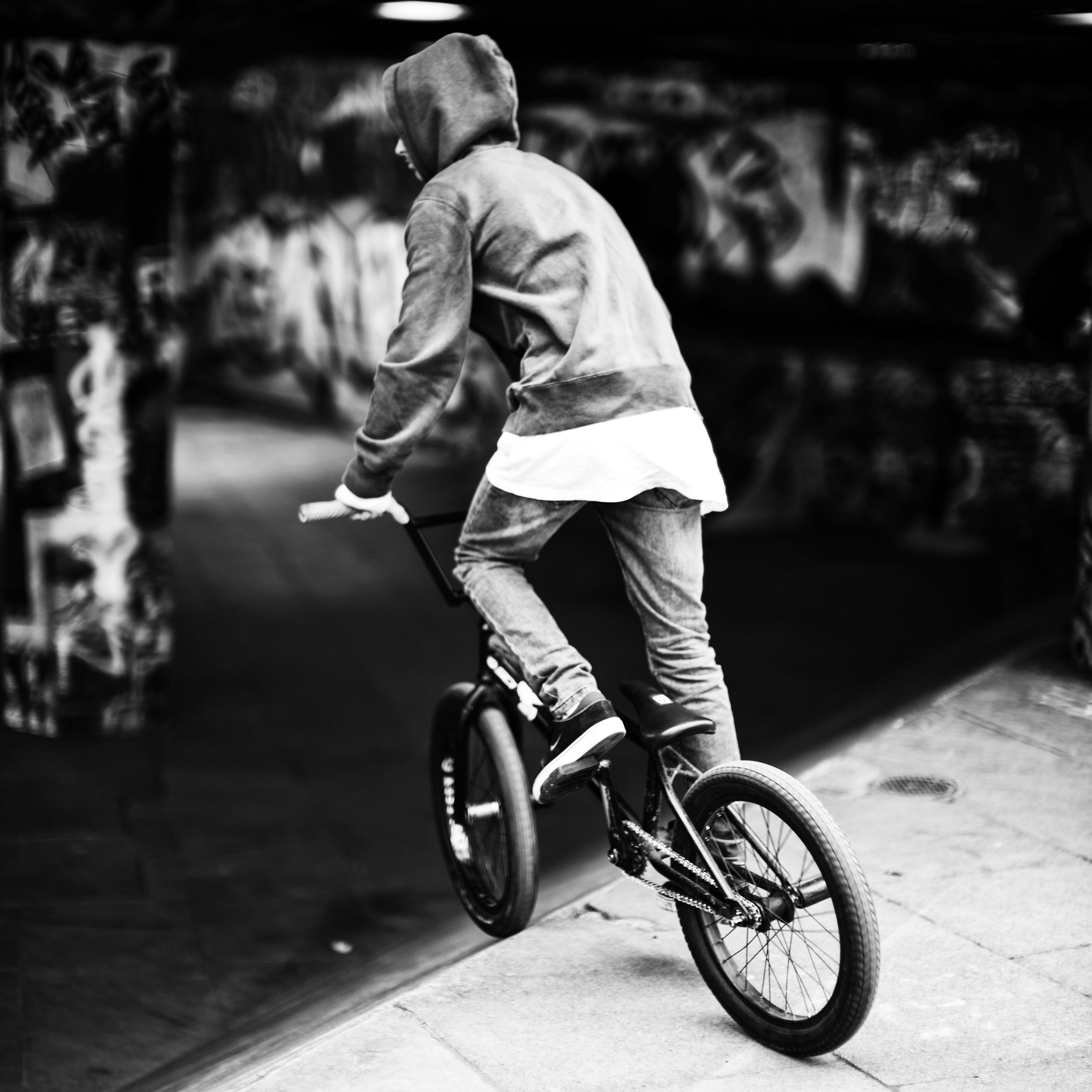 A BMX rider prepares for another trick