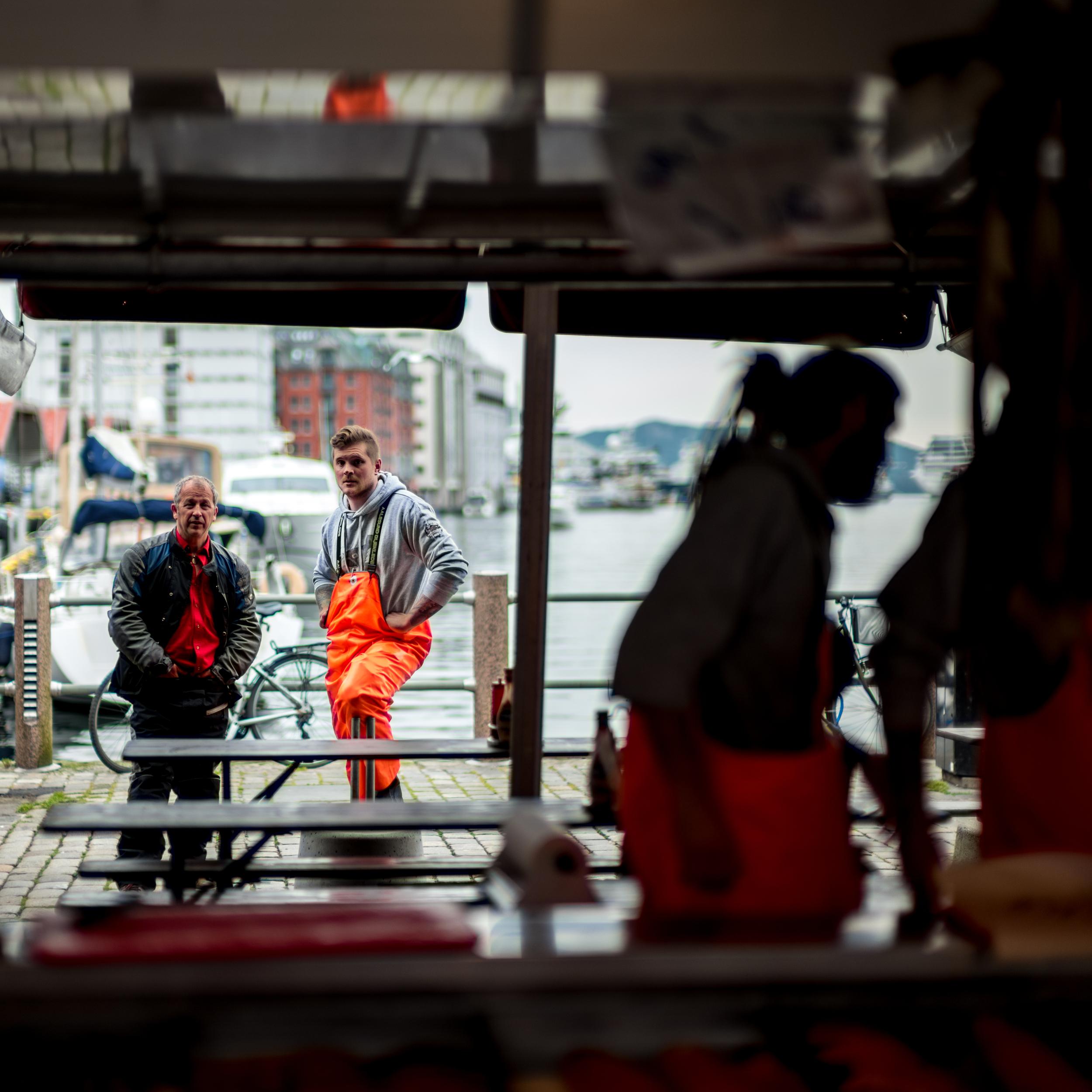 Some fishermen stop for a break in the markets of Bergen, Norway.
