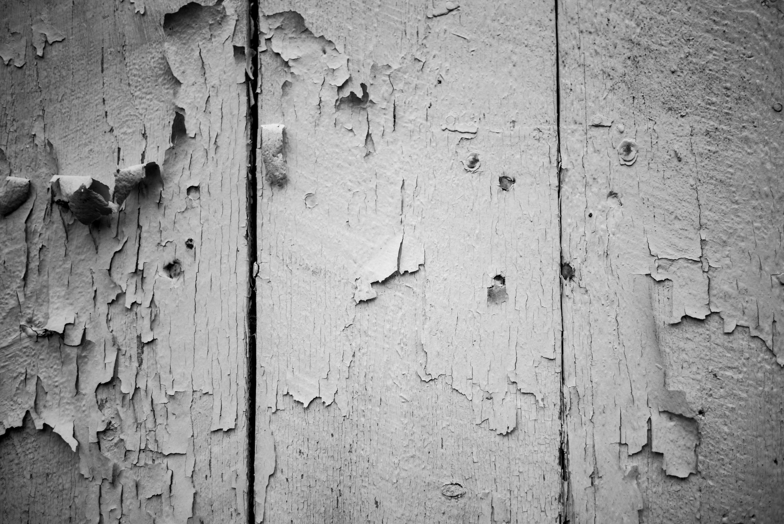 Peeling paint on the side of the shed