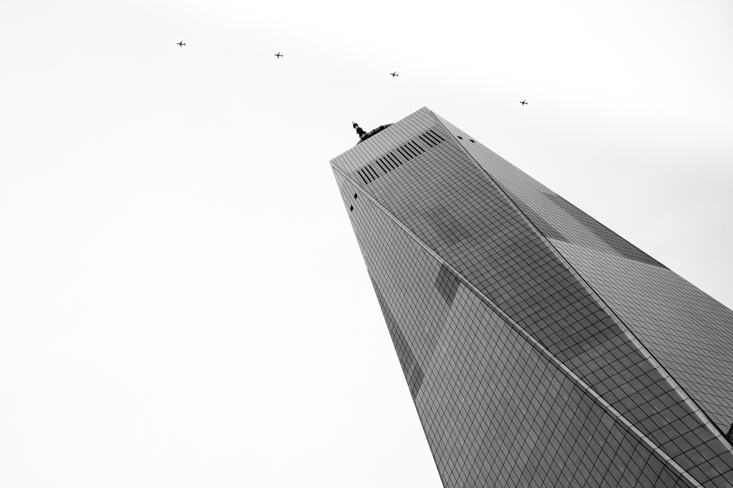 This photograph is very powerful to me. I was standing outside the museum and noticed a jetliner flying over One World Trade. My mind started racing with thoughts.... anywhere else in the world, seeing a plane fly over a building is so routine, that it hardly registers. But here, it seemed raw. This is a view similar to the one thousands saw on 9/11 - but with a very different outcome.I took four images of the plane's track over New York City and combined them in this composite.