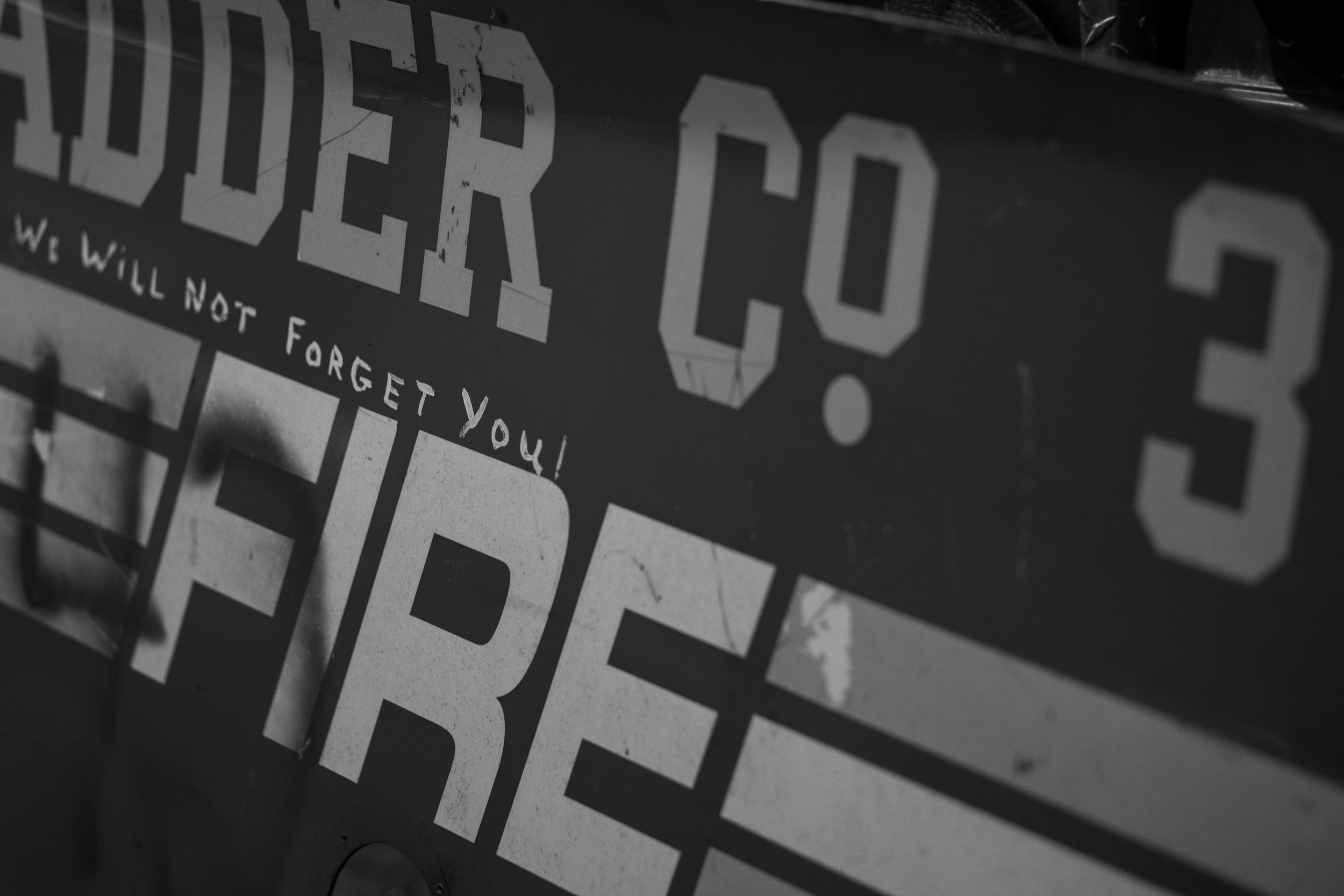 A message from supporters of Ladder Company 3; this was part of a fire truck that was smashed when the towers collapsed.