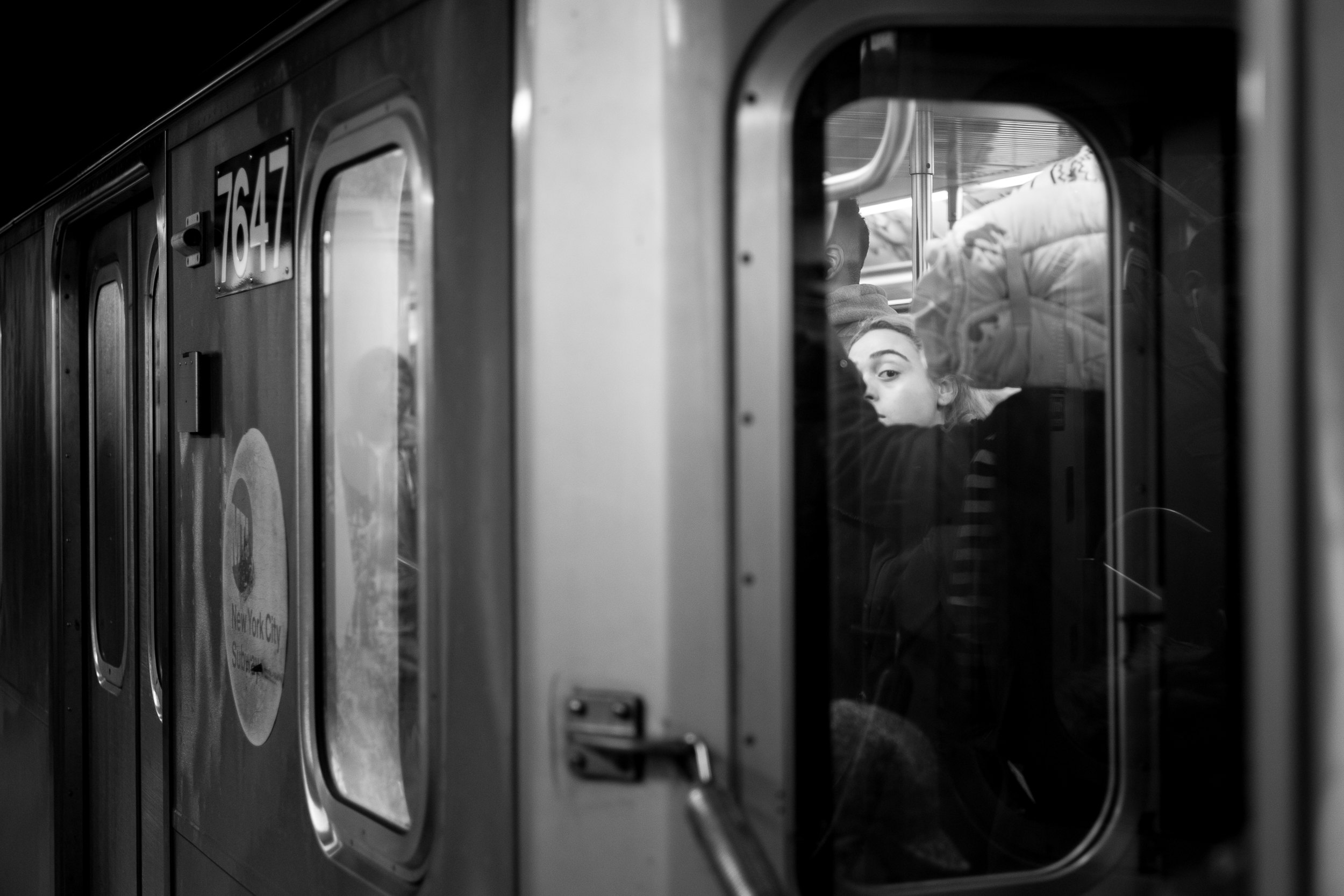 The Eye.  A passenger looks out of the window on an express train to Wall Street.  Leica M10 with 90mm Summicron f/2.