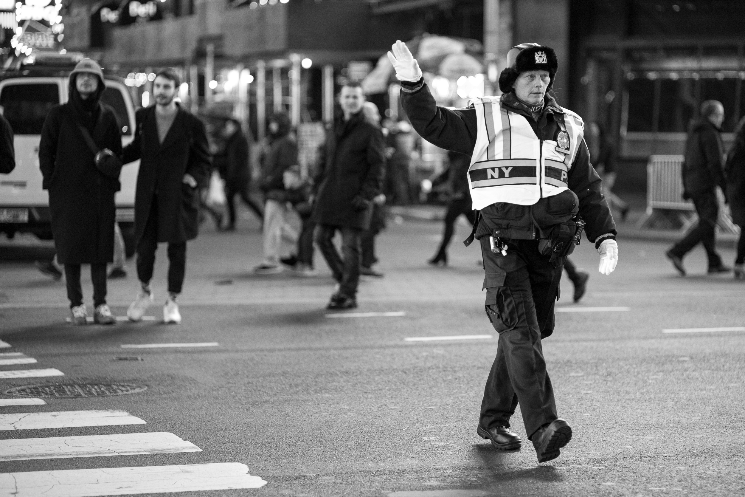 Crowd Control. A NYPD officer directs traffic and keeps the crowds safe as thousands of holiday revelers descend on New York's most popular attractions.Leica M10 with 50mm Summicron f/2.
