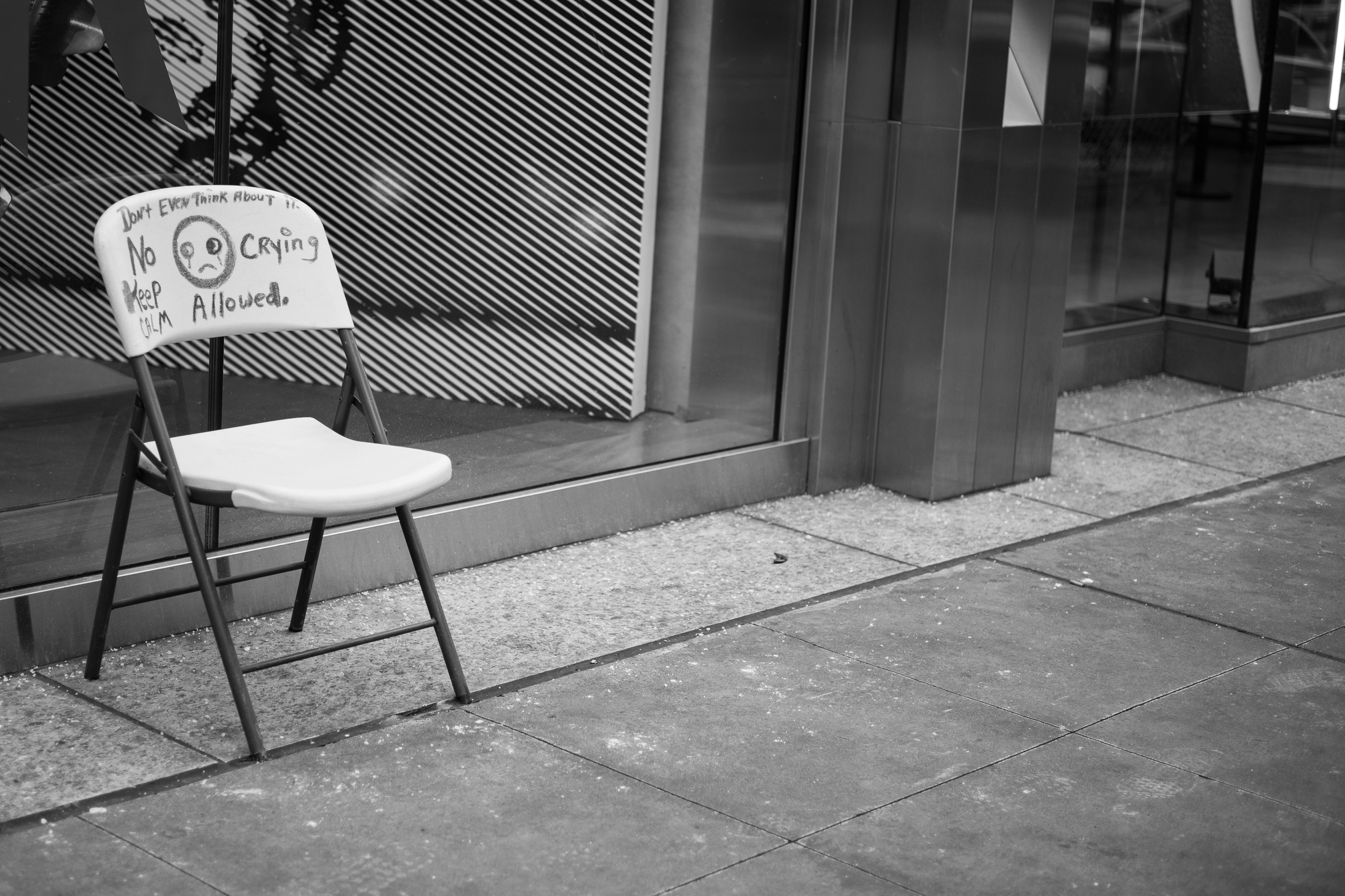 "The Message.  A simple chair might not have had the sparkle to catch my eye, but this chair, with the ""No Crying Allowed"" message caught my eye.  Leica M10 with 90mm Summicron f/2."