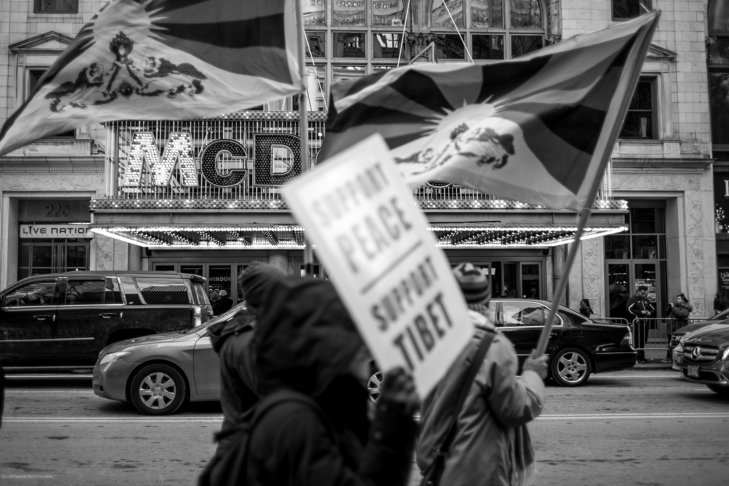 Pro-Tibet rally participants march in front of one of America's icons of global consumerism.... McDonalds. Leica M10 with 35mm Summicron f/2.