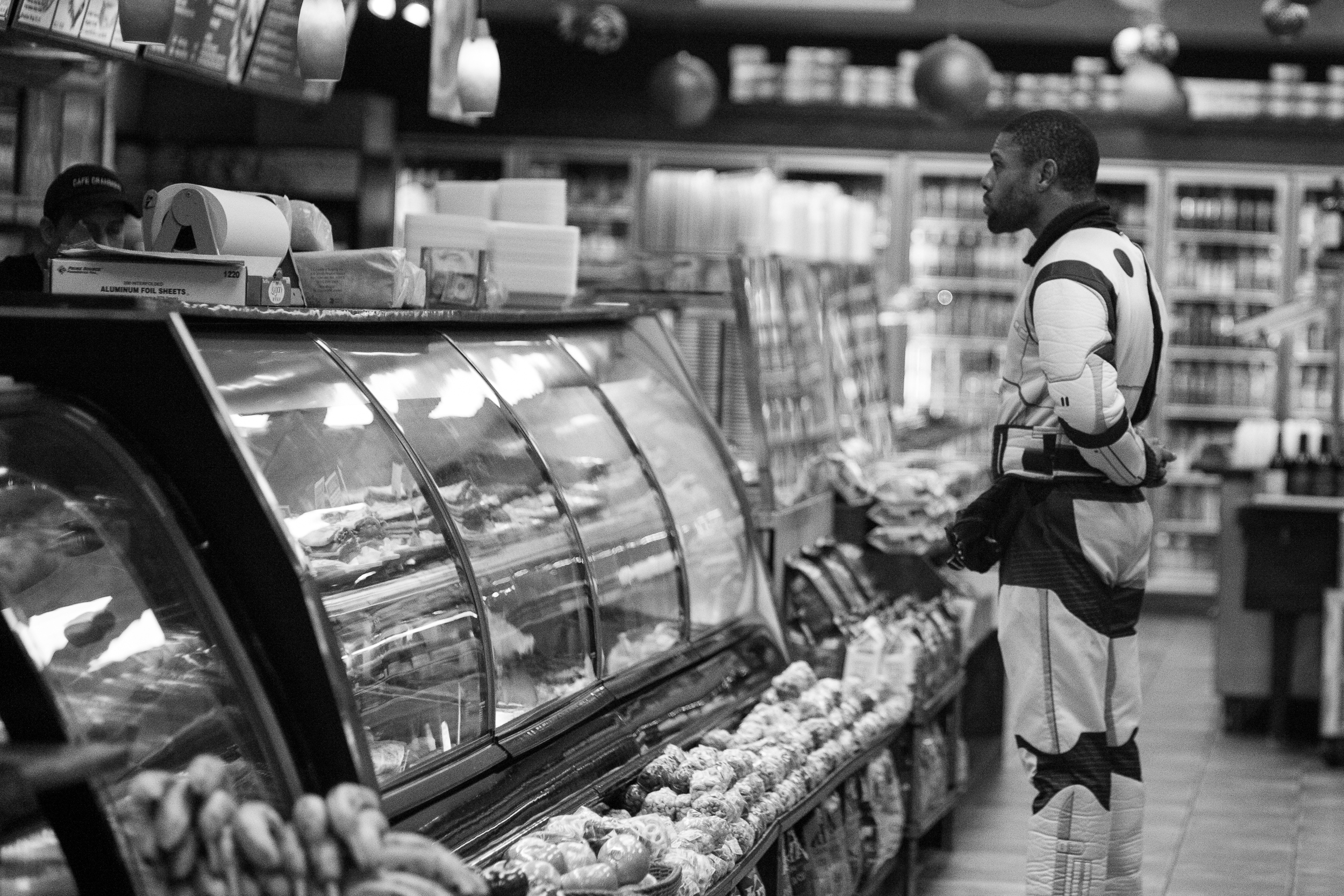 Stormtrooper's Have to Eat. This man was dressed in a Stormtrooper costume, but had stopped at a deli to get a snack. Leica M10 with 90mm Summicron f/2.