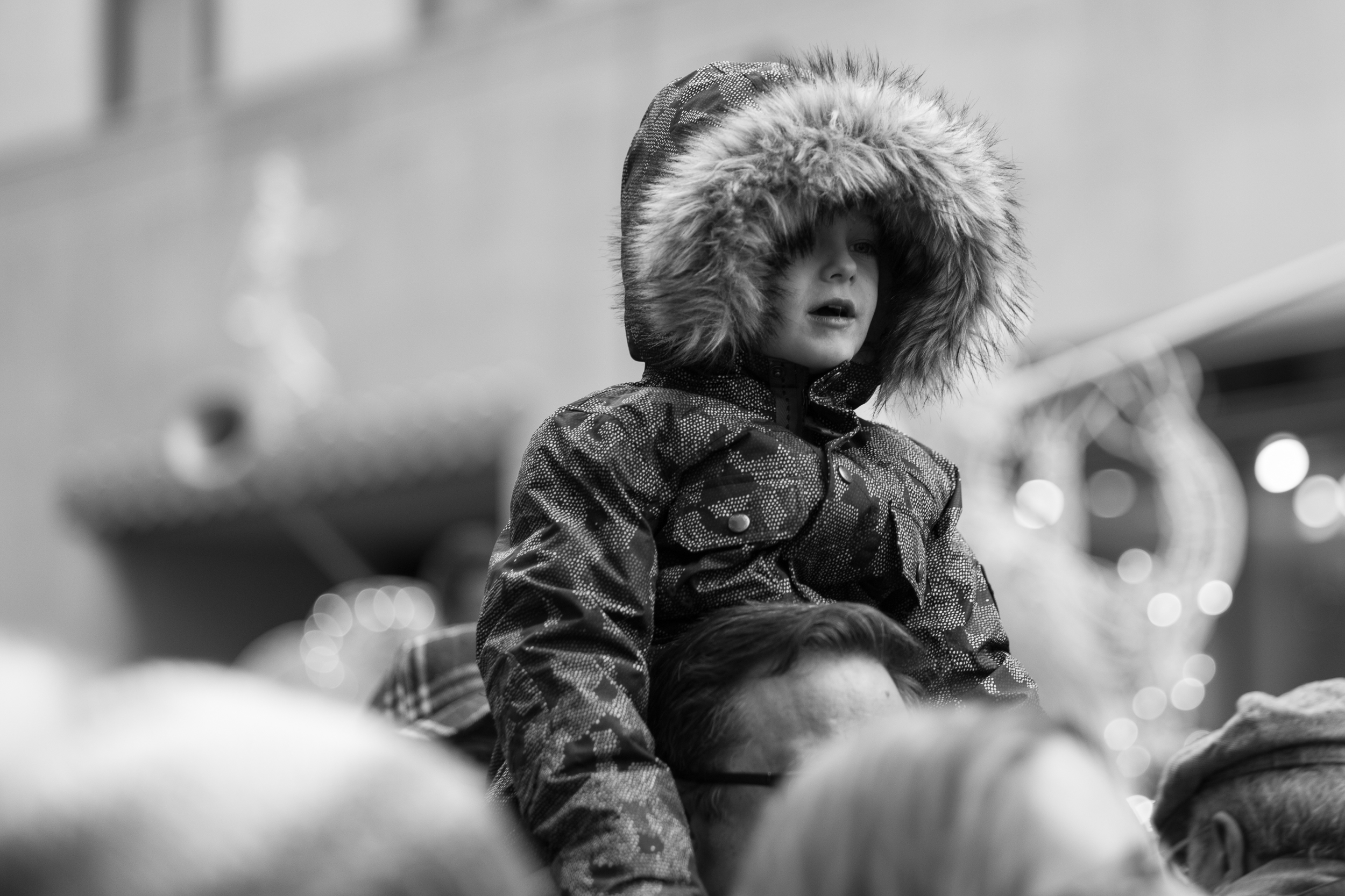 The View. A boy is carried on his dad's shoulders to see the holiday tree in Rockefeller Center. Leica M10 with 90mm Summicron f/2.