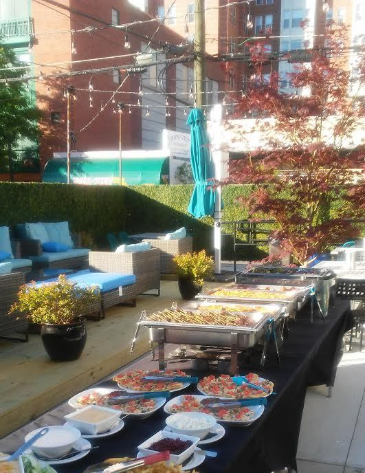 The Beer Garden    A large outdoor patio space  that holds 300 people with telescoping shade umbrellas, comfy couch lounge areas an expanded beer list and beautiful sunsets.  We typically reserve 1/4 to 1/2 of the space depending on the size of the group.