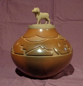 Traditionally burnished and fired brown/red Bighorn Sheep Ram lidded Jar with fire clouds