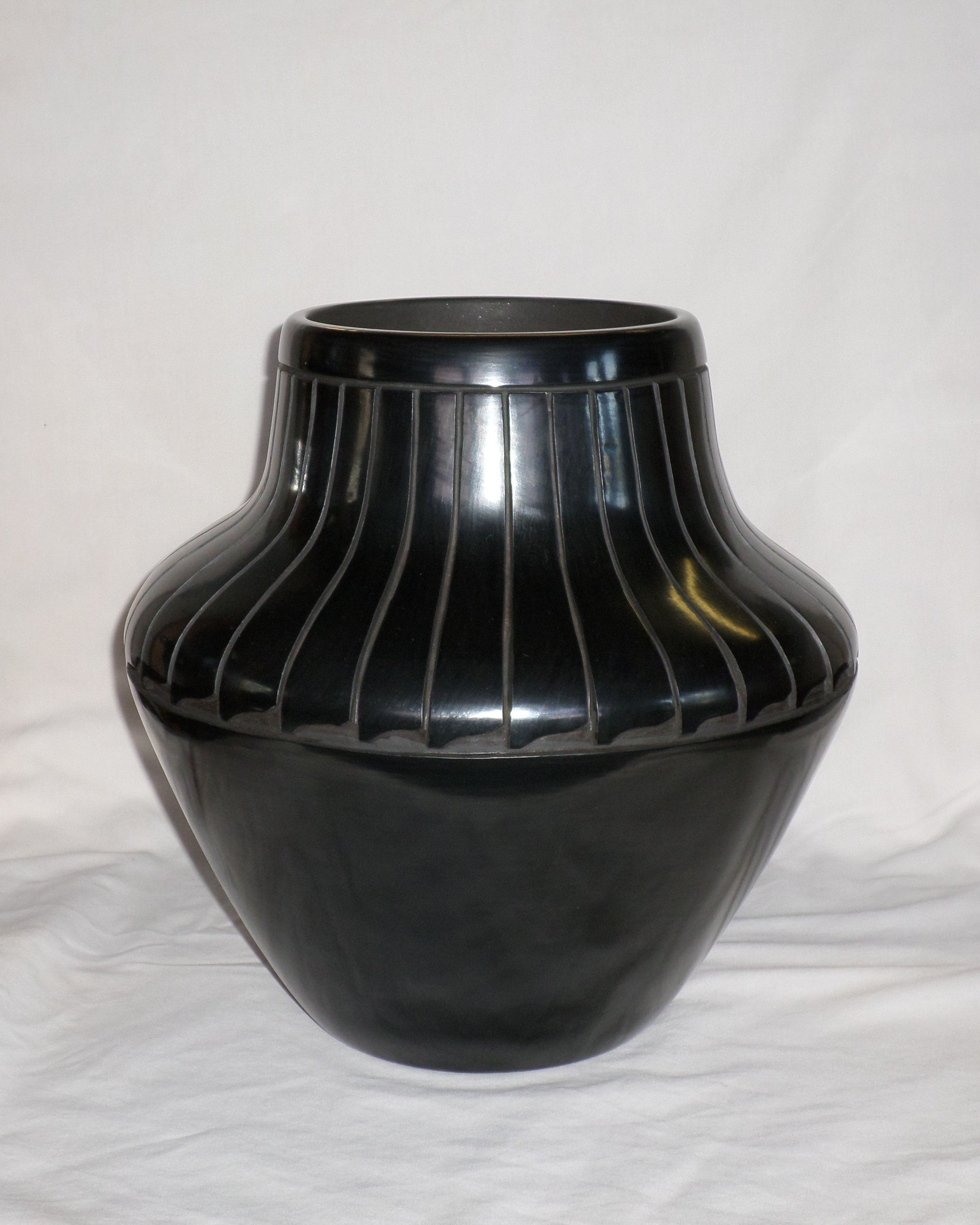 "Black Feather Design Water Jar  12-1/4"" H X 12-3/8"" Dia.  Price: $2,800."