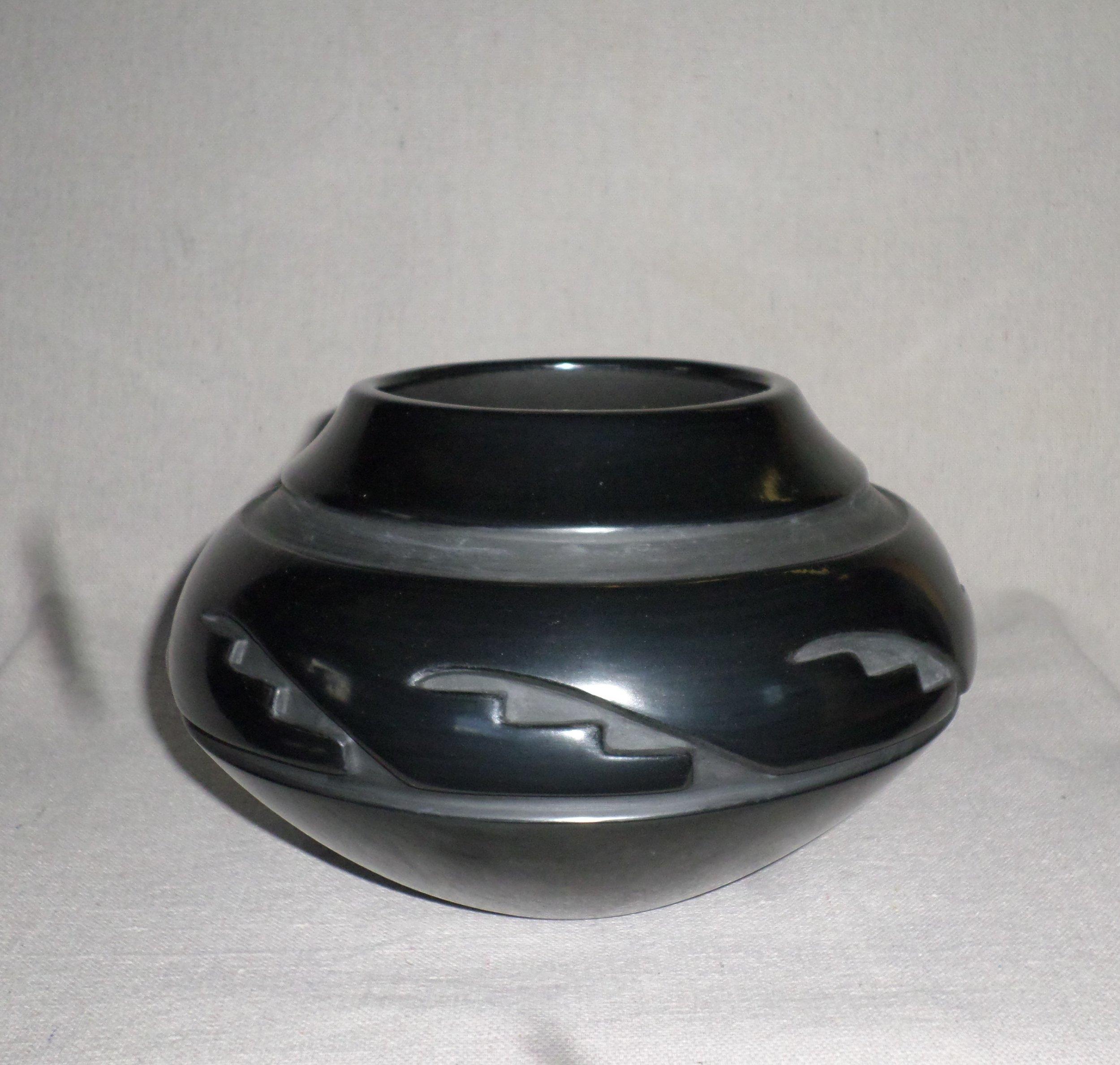 """Black carved Kiva Step Desjgn Jar  5-1/4"""" H X 8-3/8"""" Dia.  Price $2,200."""