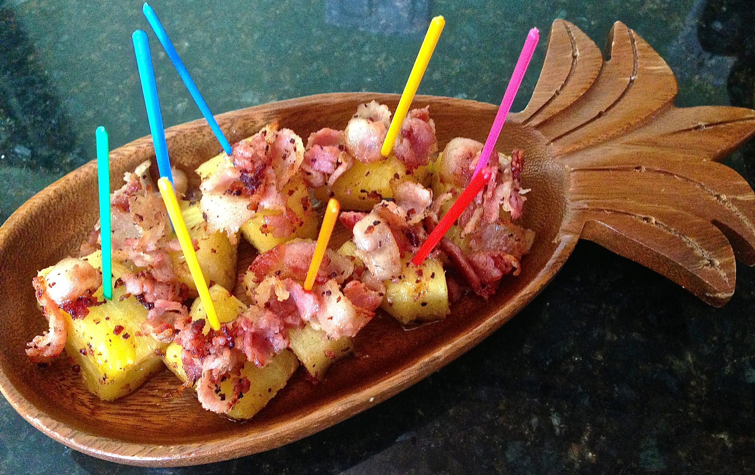 Place pineapple on platter, top with bacon, poke with a fancy pick.