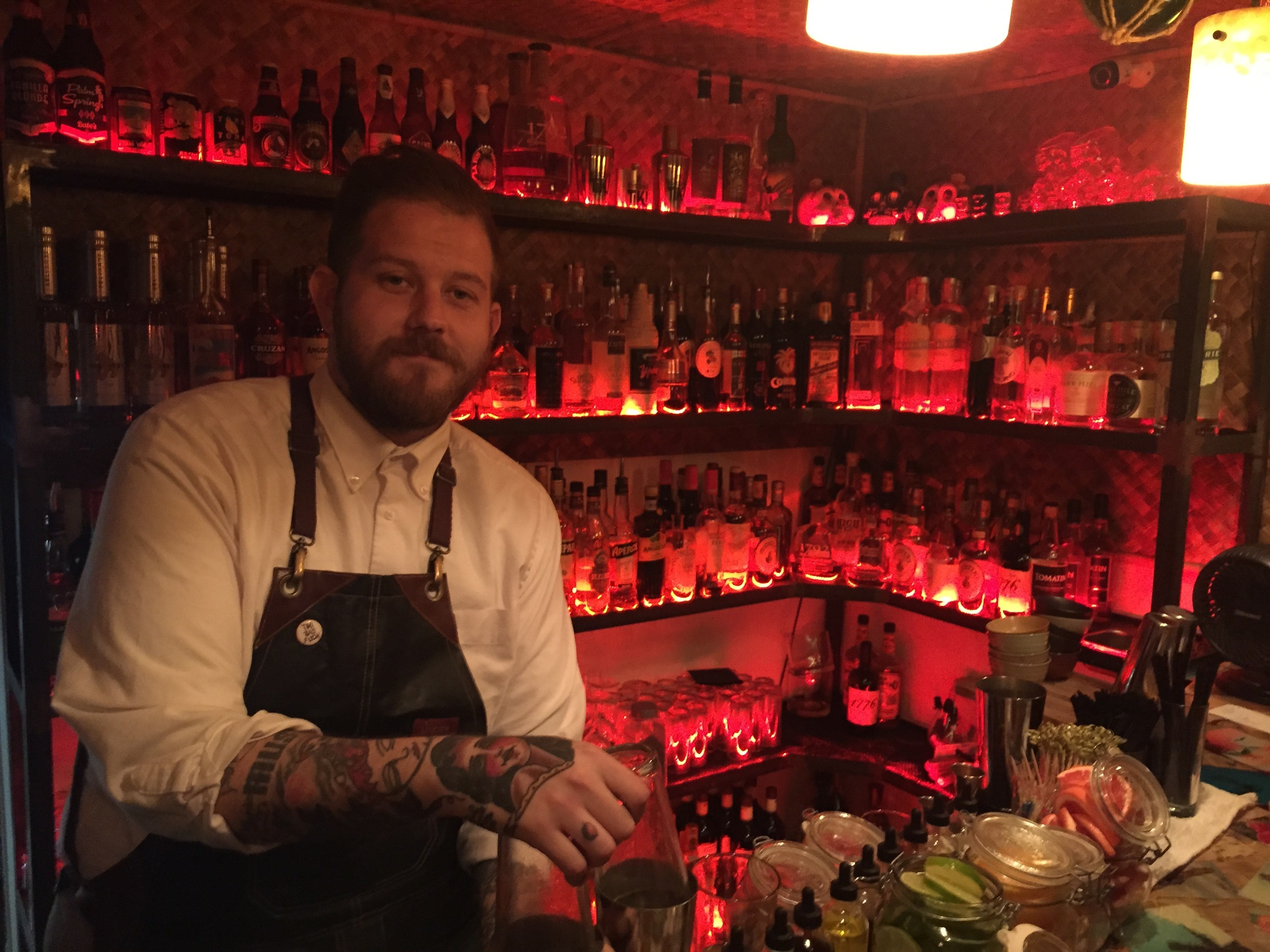 Head bartender Chad Austin prepares the next round of cocktails at Bootlegger Tiki