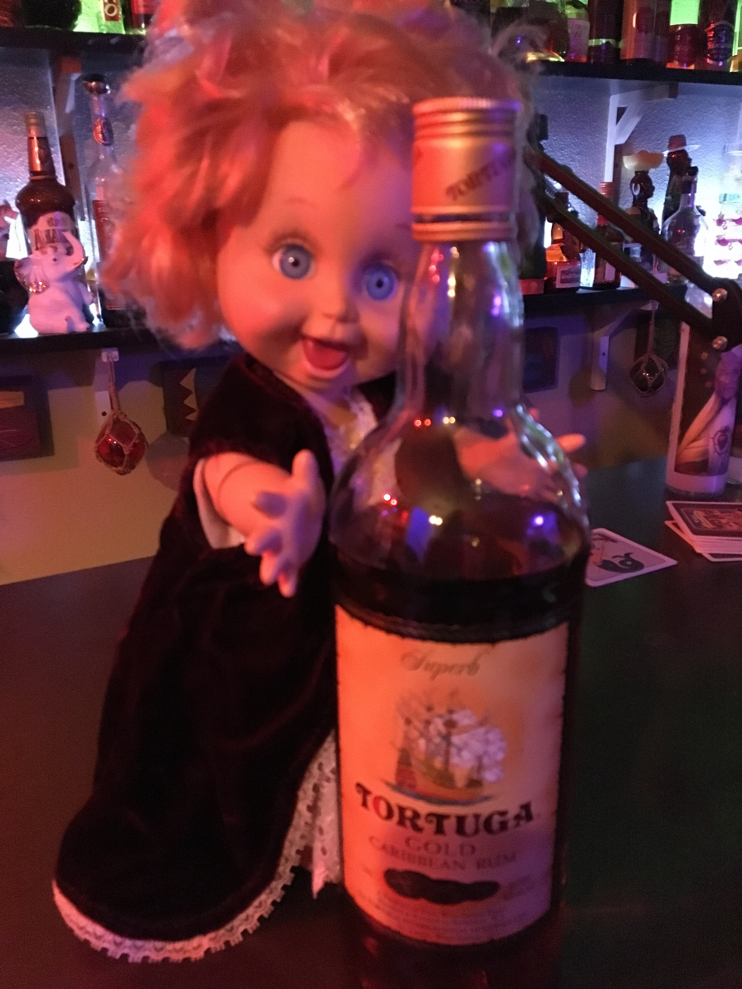 One of the greatest thing about a gag gift exchange is receiving creepy items like this one.  This crazy eyed baby doll was just sitting around for decades until wrapped up and given to Sunshine to go with all his rum.