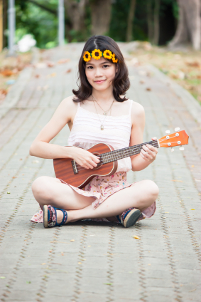 The size of a Ukulele is more proportional for the younger player.