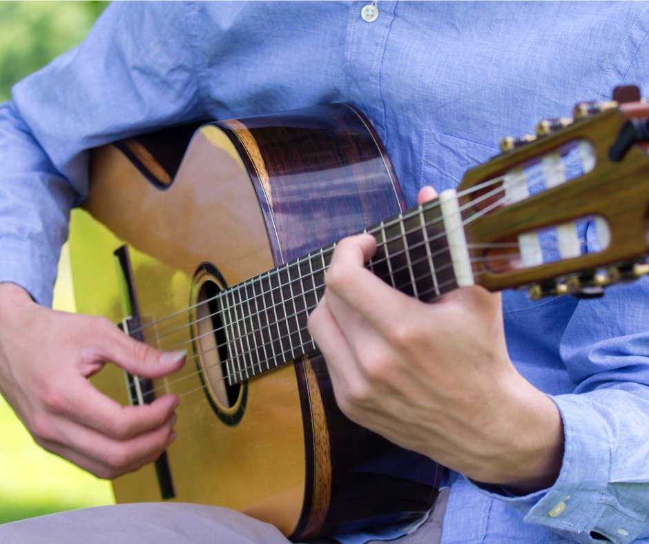 young-male-playing-a-classic-guitar-outside-picture-id479935576.jpg