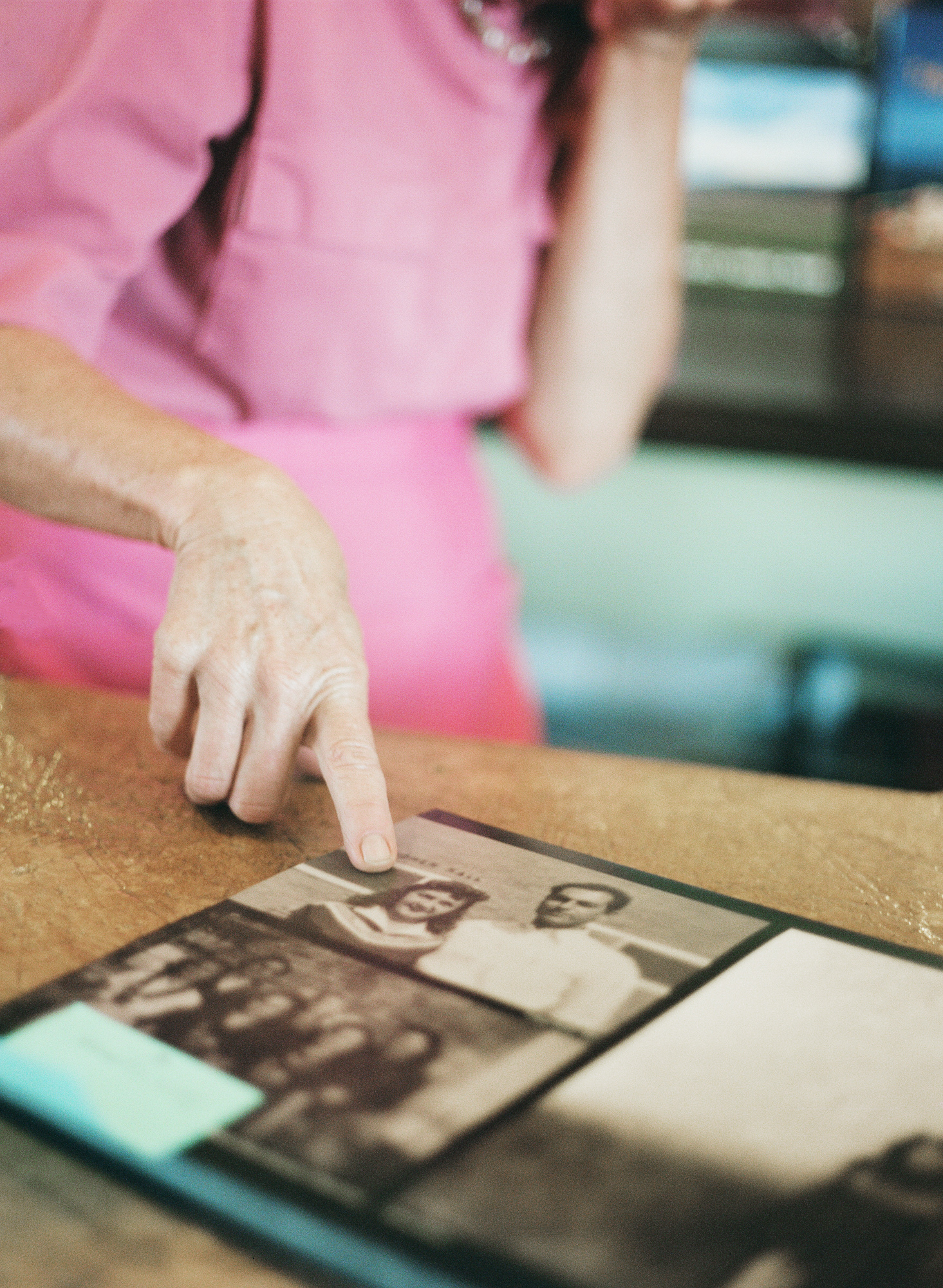 Sheree shows a family album from the settlement of her town in the cafe she works at. Her family settled the town, she has been driving since she was 7, and she knows all the best hot springs in the area. Fayette, population 249. Fall 2014.