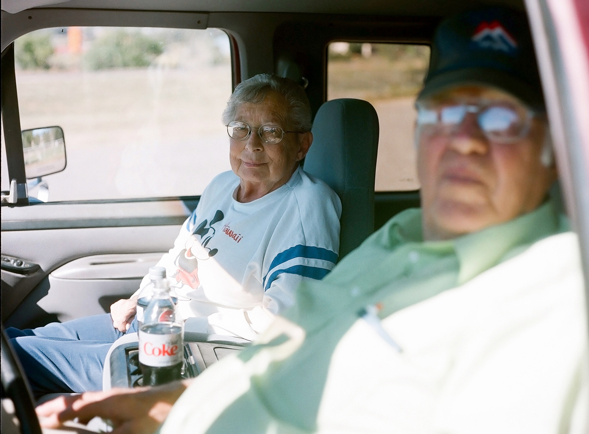 A couple sit in their car enjoying Diet Coke and a view after dumping yard waste outside of town. Escalante, population 793. October 2013.