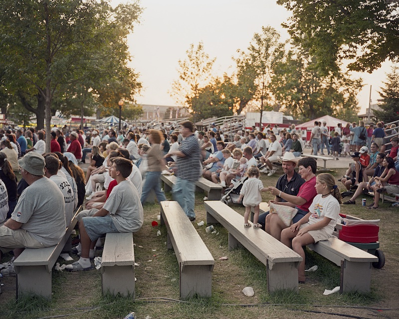 Baby on Bench, Iowa State Fair, Des Moines, Iowa, 1999 byMike Sinclair  Archival Pigment Print