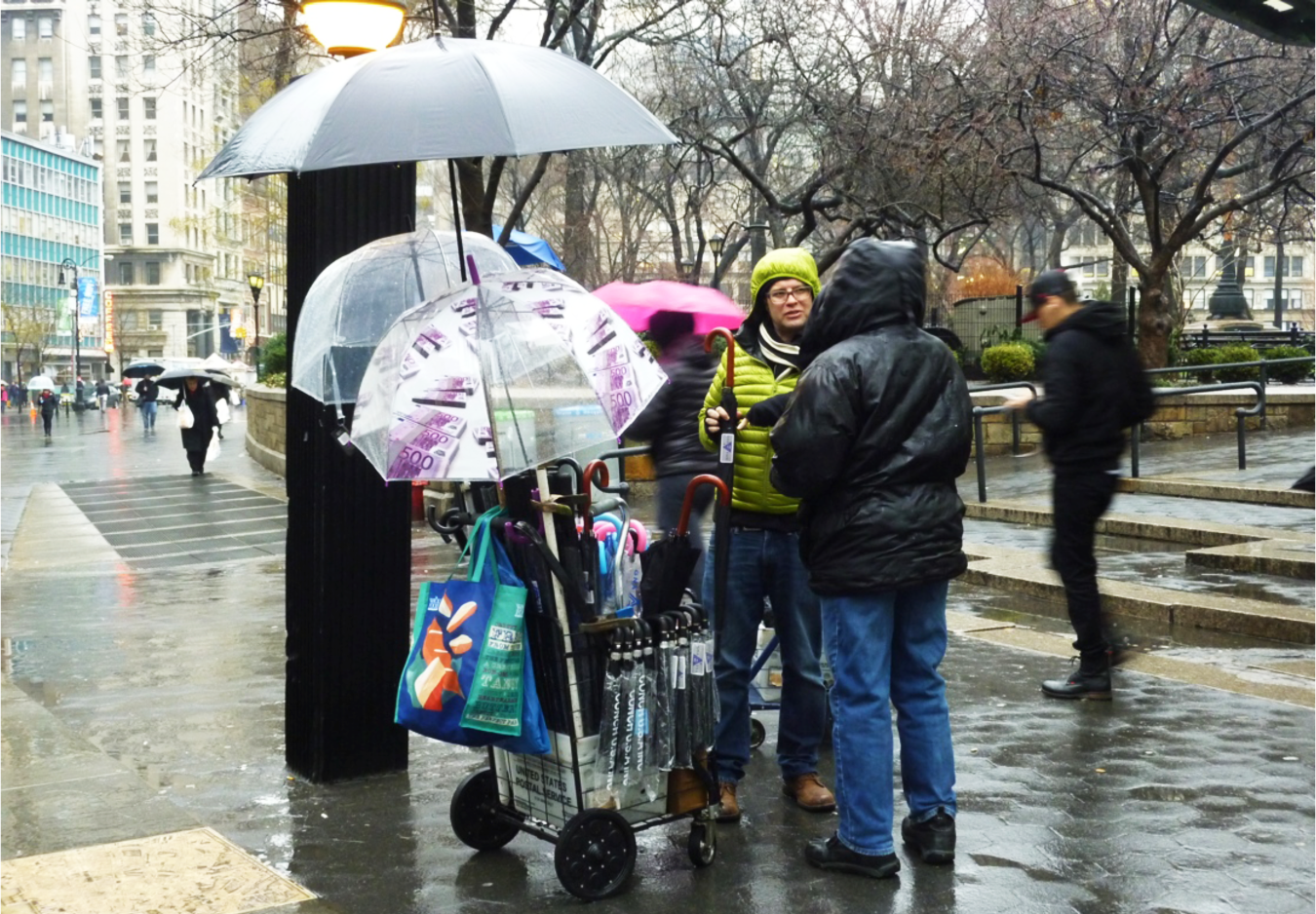 Team member interviewing a licensed veteran vendor selling umbrellas at Union Square Plaza on a rainy winter afternoon. Source: Aseem Inam