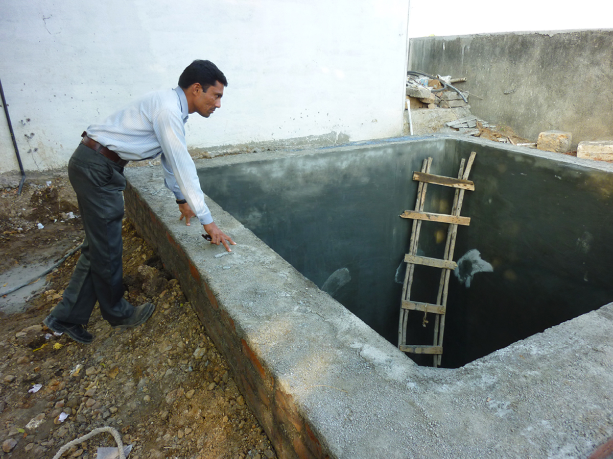 Since the Saurashtra region of Gujarat is prone to periodic droughts, new housing construction within the program integrates the design of underground water cisterns.  Source:  Aseem Inam