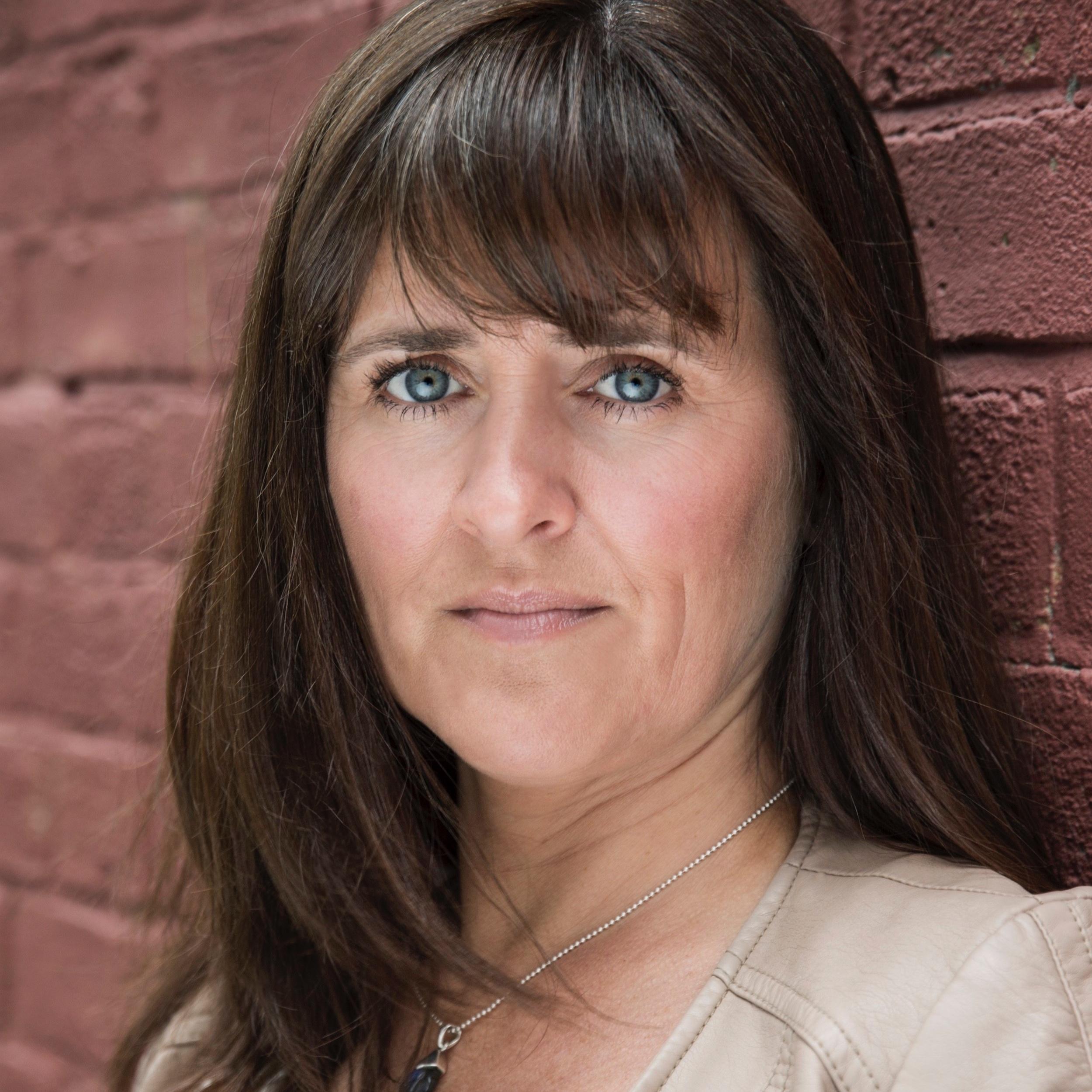 Headshot 1 jpg Laura Kelly.jpg