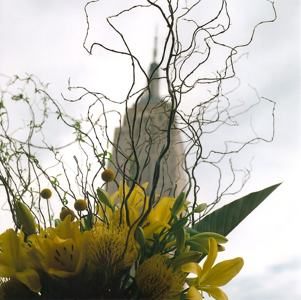 The floral arrangements at Sandy's wedding and the Empire State Building behind