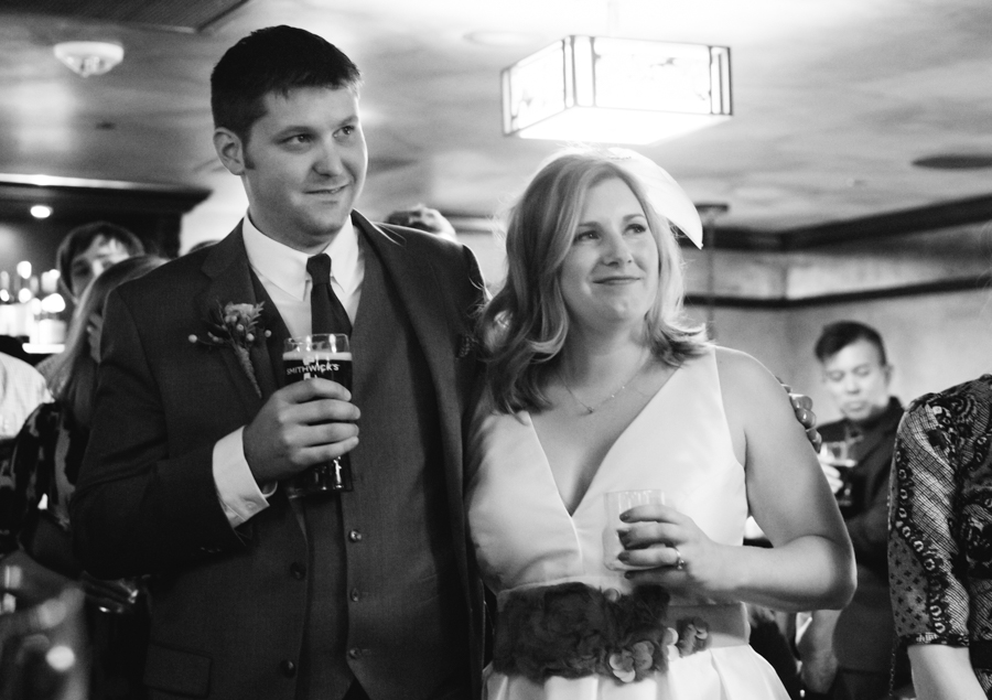 The bride and groom listening to the toast...